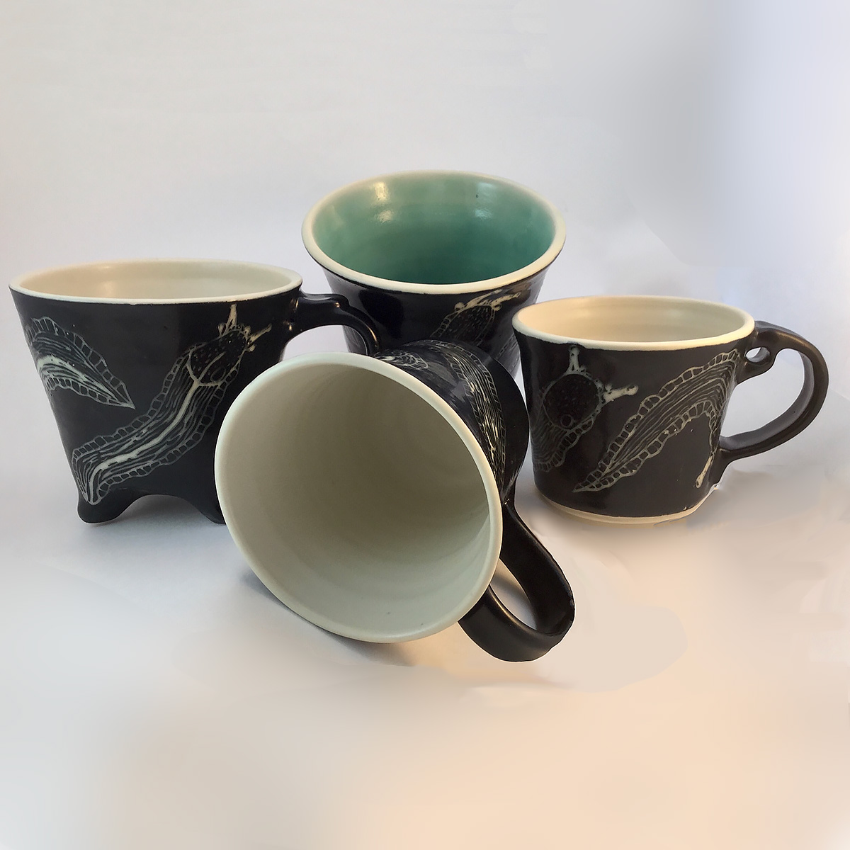 Four Slug Mugs